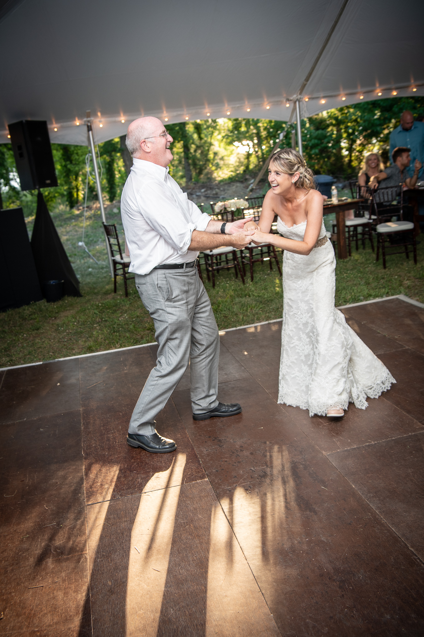 father and bride laughing and dancing