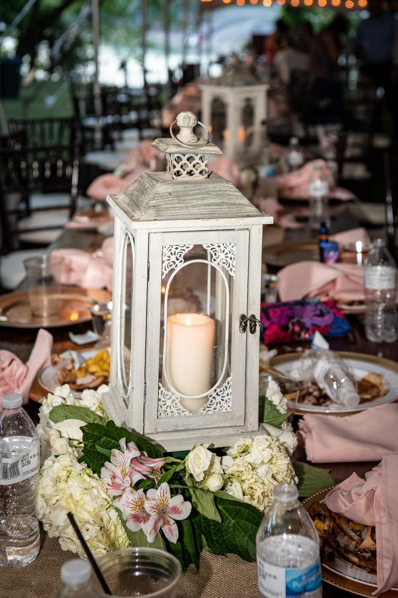 lantern and floral wedding centerpiece