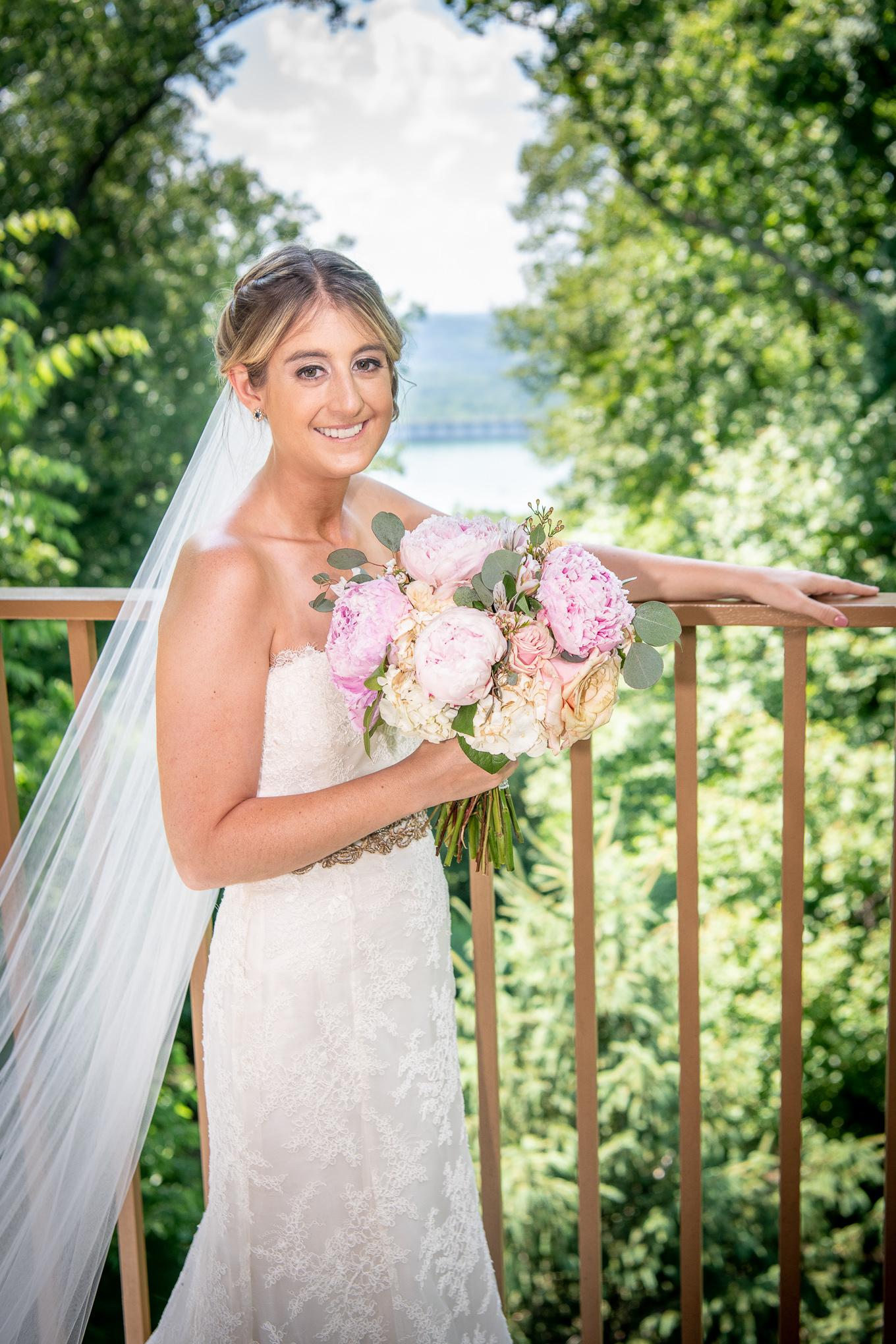 Bride portrait holding her bridal bouquet